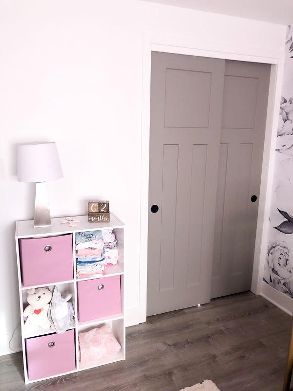 Baby girl nursery closet and storage shelf.