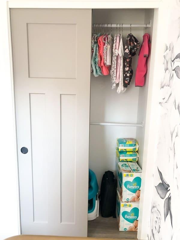 Home Depot closet organizer by closetmaid installed in baby girl nursery closet.