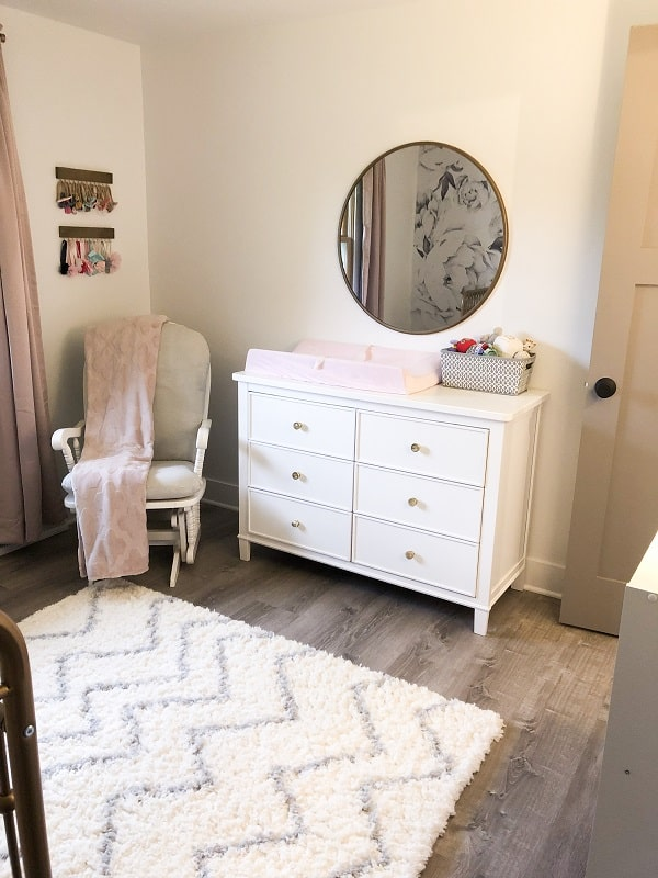 Baby girl nursery with gray, blush and gold accents.