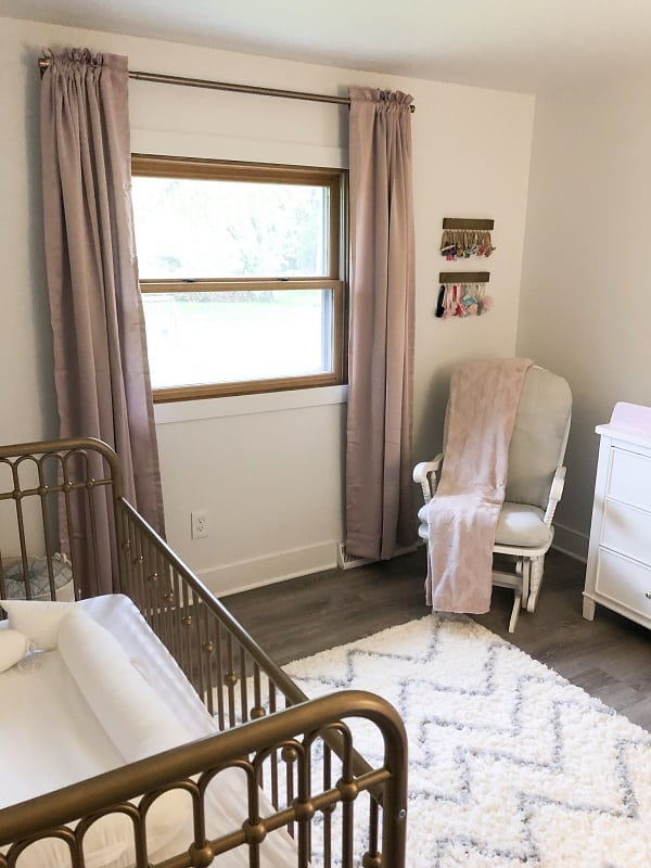 Baby girl nursery with blush, gray and gold accents.