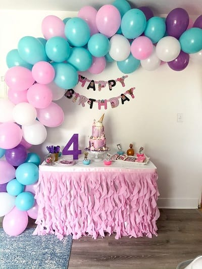 LOL Surprise Birthday Party cake table and balloon garland