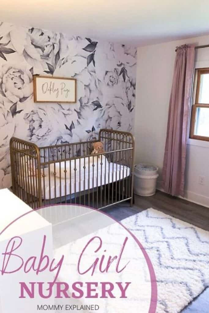Nursery for baby girl with gold crib and blush curtains.