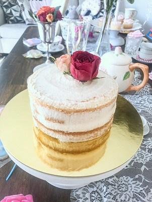Crumb coat smash cake with roses.